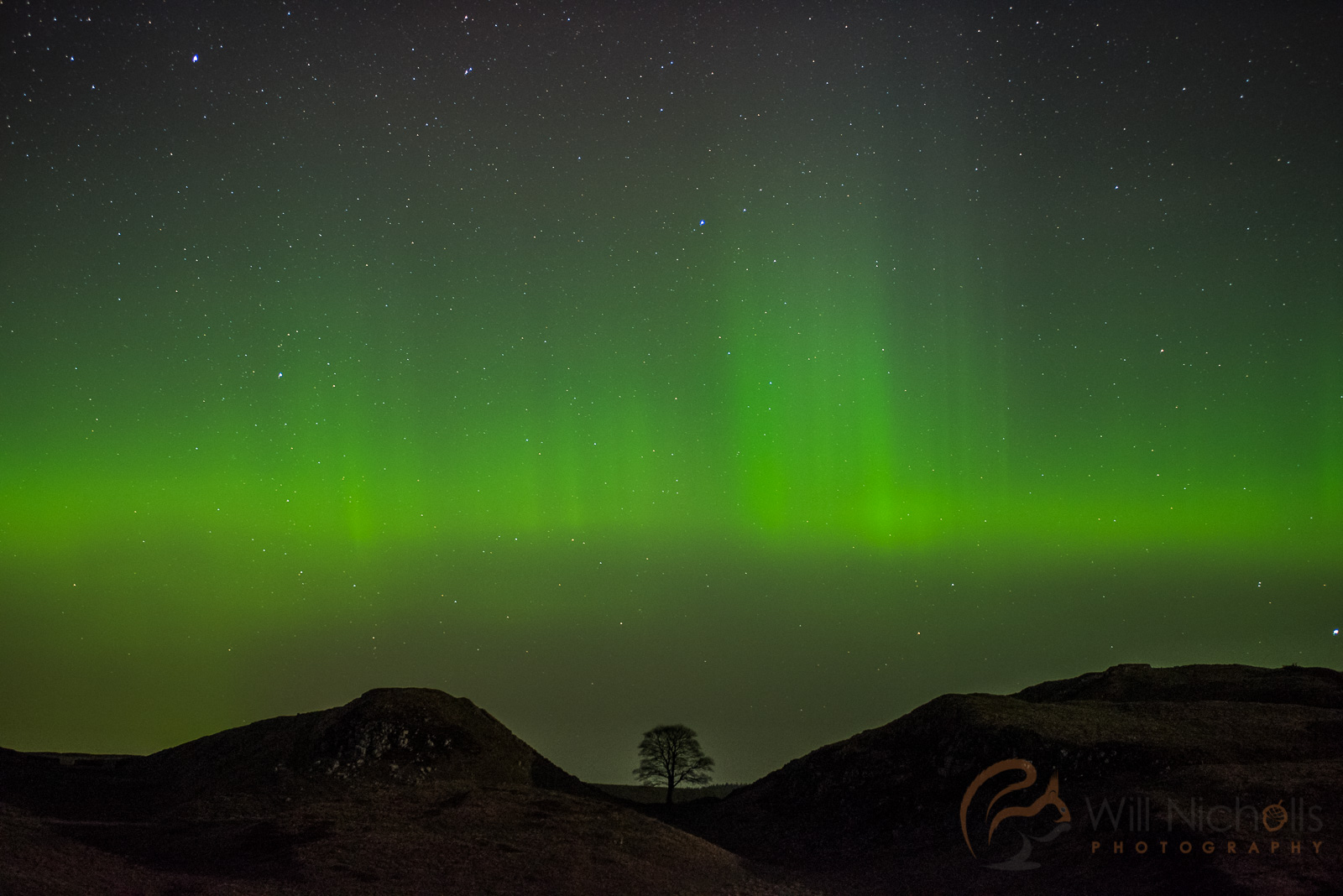 The Northern Lights at Hadrian's Wall in Northumberland, England.