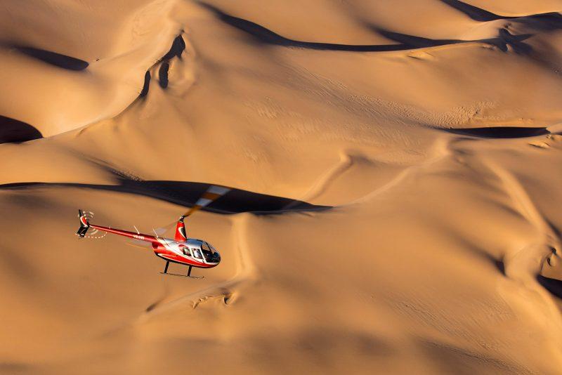 Helicopter flying over deserts