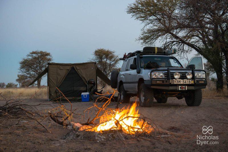 Kalahari camp and camp fire and jeep